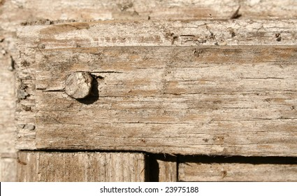 A close-up of an old wooden frame
