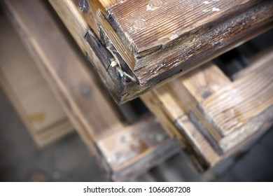 Closeup of old wooden window frames, paint removed. Narrow DOF.