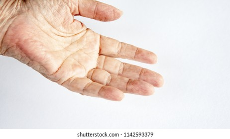 closeup of an older womans hand on white background