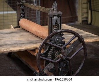 Close-up of a old-fashioned metal and timber wringer