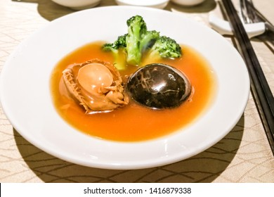 Closeup on abalone with mushroom and broccoli dish. Expensive Chinese dish during celebration