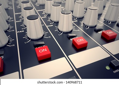 Closeup on adjusters and red buttons of a mixing console. It is used for audio signals modifications to achieve the desired output. Applied in recording studios, broadcasting, television.