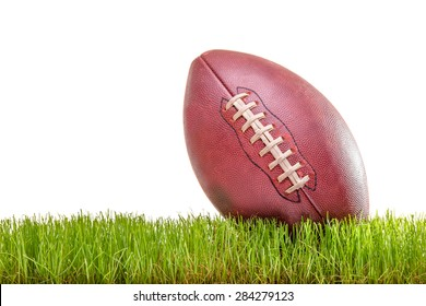 Close-up on an American football on a grass surface isolated on white background