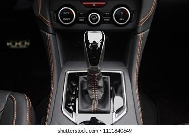 Close-up on automatic transmission lever in modern car. Car interior details. Transmission shift.