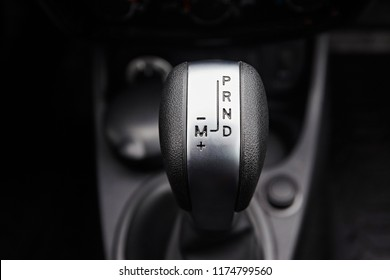 Close-up on automatic transmission lever in modern car. Car interior details. Transmission shift.