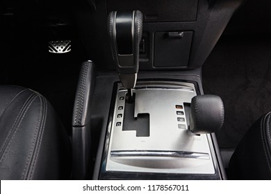 Close-up on automatic transmission lever in modern car. Car interior details. Transmission shift. The second lever to control the lowered transmission and transfer box SUV