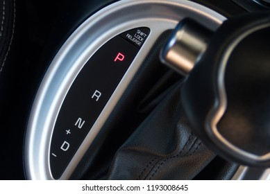 Close-up on automatic transmission lever in modern car. Transmission shift with selective focus and crop fragment