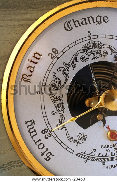 """Close-up on a barometer, needle pointing to """"stormy"""""""