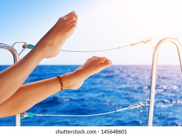 Closeup on beautiful sexy women's feet on the yacht, carefree vacation, journey on sailboat, happy and healthy lifestyle, pleasure concept