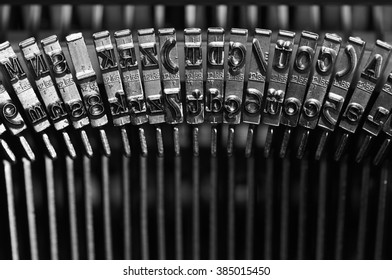 Closeup on the black and inky keys of an antique typewriter