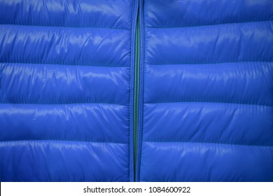 Close-up on blue puffer jacket texture