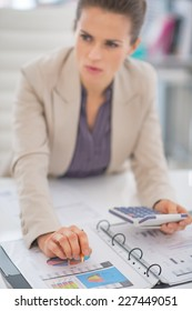 Closeup on business woman working with documents in office