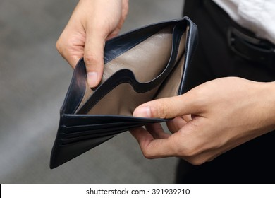 closeup on a businessman with empty wallet