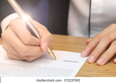 close-up on a businessman hand signing a contract paper