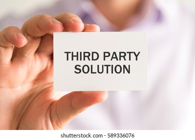 Closeup on businessman holding a card with THIRD PARTY SOLUTION message, business concept image with soft focus background and vintage tone