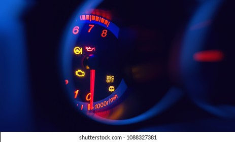 close-up on car dashboard and warning icon