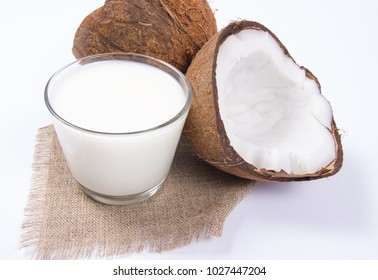 CloseUp on a coconut with coconut milk isolated on white background.