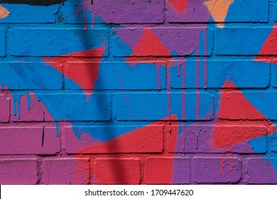 Closeup on colorfully painted brick abstract texture background with detail.