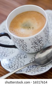 Close-up on a cup of coffee with brown sugar