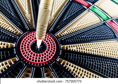 Close-up on dart pin on board bullseye. Strategy, Achievement and Success concept.
