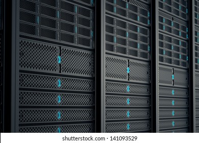 Closeup on data servers while working. Blue LED lights are flashing. Image can represent cloud computing, information storage, etc. or can be the perfect technology background.