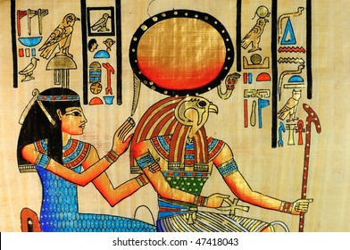 Closeup on egyptian papyrus with Horus and queen