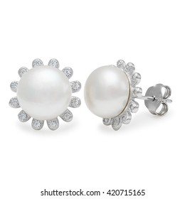 Close-up on elegant pearl and diamond stud earrings over white background with slight set down shadow
