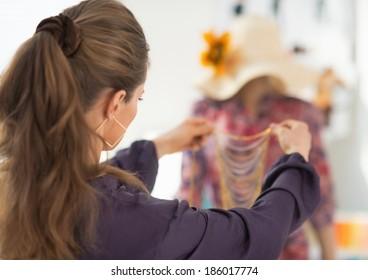 Closeup on fashion designer choosing accessories