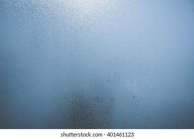Closeup on fog condensation on window glass background