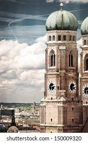 Closeup on Frauenkirche tower in Munich, Germany. Aged photo on old paper texture