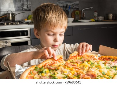 Closeup on happy eating pizza on the wooden table. Hands taking pizza from table, closeup. food, leisure and friendship lifestyle