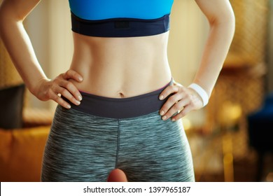 Closeup on healthy woman in sport clothes at modern home.