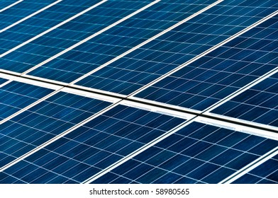 Close-up on large solar panels in photovoltaic park