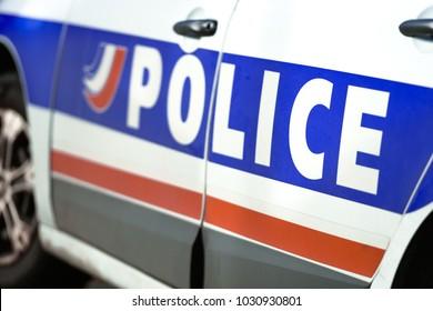 closeup on logo of urban police car