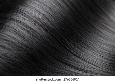 Closeup on luxurious straight and glossy black hair