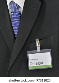 Closeup on male business suit and conference delegate badge