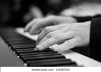 Close-up on a man's hand playing the piano