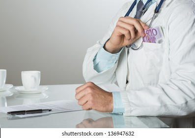 Closeup on medical doctor hands, taking money