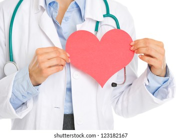 Closeup on medical doctor holding paper heart