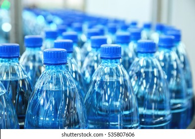 Closeup on mineral water bottles in raw and lines - Shutterstock ID 535807606