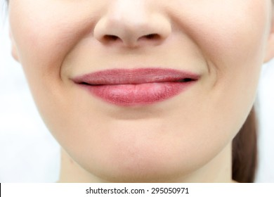 Closeup on mouth of females smiling face