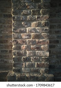 closeup on a new built brick wall. Warm evening light coming from the left.
