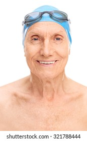 Close-up on an old man with a blue swim cap and black swimming goggles isolated on white background