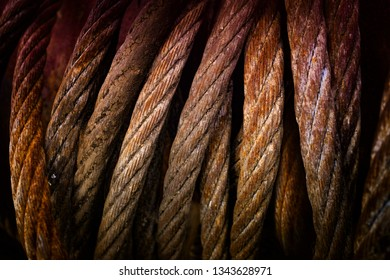 Closeup on old and rusty steel cable