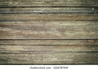 Closeup on old wood with natural textured grungy striped patterns weathered rough detail photo