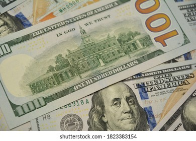 A close-up on One Hundred Dollar Banknotes, bills, American Dollars Cash Money as a concept of investing, savings, interest-earning on money.