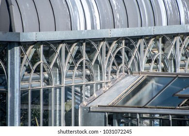 Closeup on part of the roof and windows of a greenhouse on winter time