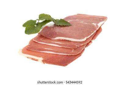 closeup on a piece of spanish serrano ham, isolated on white