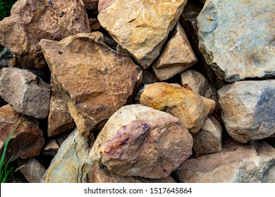 Close-up on piles of stones. Background with big stones