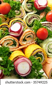 Closeup on platter of assorted meat tortilla wraps